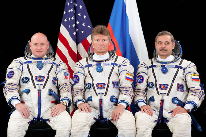 The prime crew members for International Space Station Expedition 43 take a break in training for a crew portrait. From left are Flight Engineers Scott Kelly of NASA, Gennady Padalka and Mikhail Kornienko of Roscosmos. Kelly and Kornienko will be spending an entire year in space on board the ISS. Image Credit: Roscosmos/GCTC