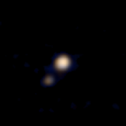 This image of Pluto and its largest moon, Charon, was taken by the Ralph color imager aboard New Horizons on April 9, 2015, from a distance of about 71 million miles (115 million kilometers). It is the first color image ever made of the Pluto system by a spacecraft on approach. Image Credit: NASA/Johns Hopkins University Applied Physics Laboratory/Southwest Research Institute