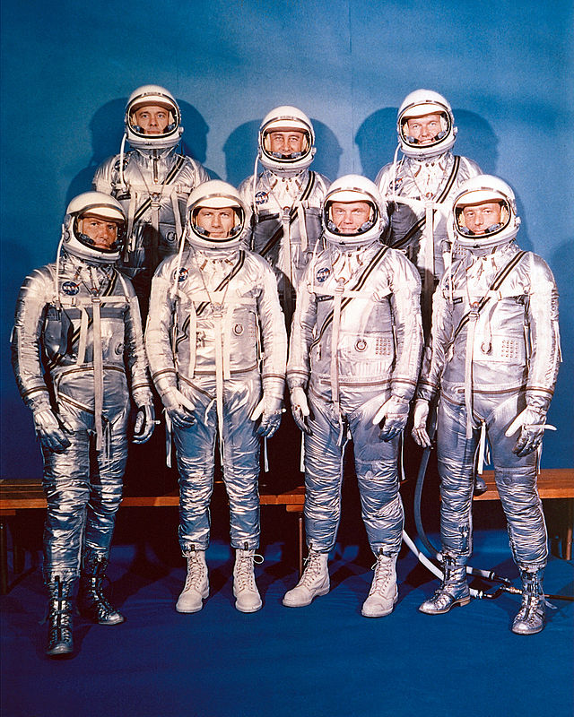 The Mercury Seven in 1960. Back row: Shepard, Grissom, Cooper; front row: Schirra, Slayton, Glenn, Carpenter. This was the only time they would appear together in pressure suits. Slayton and Glenn are wearing spray-painted work boots. Image Credit: NASA