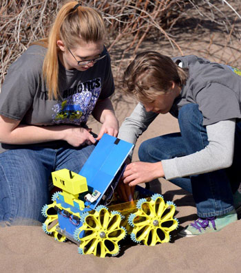 Co-captains Mary Carpenter and Hayden Alworth with BEK.E, the robot. Image Credit: Trinidad State