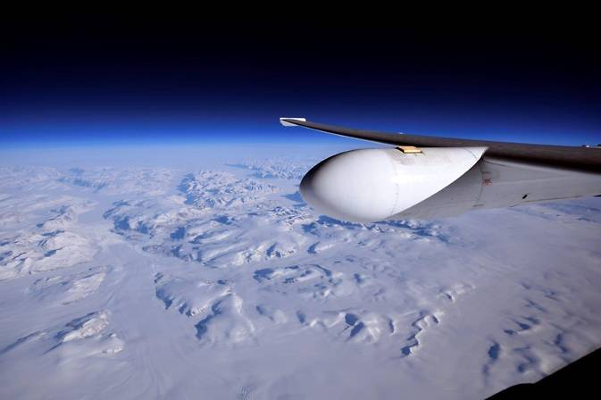 NASA's ER-2 flies high over the ice and snow of Greenland at approximately 70,000 feet during a recent mission to validate data and sensors onboard the Suomi-NPP and other NASA satellites. Image Credit: NASA Photo / Stu Broce