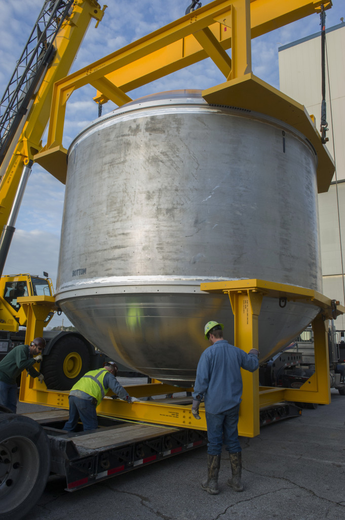 A massive cryogenic tank is loaded onto a truck at NASA's Marshall Space Flight Center to be moved to a dock on the Tennessee River in Huntsville, Alabama. Image Credit: NASA/MSFC/Emmett Given