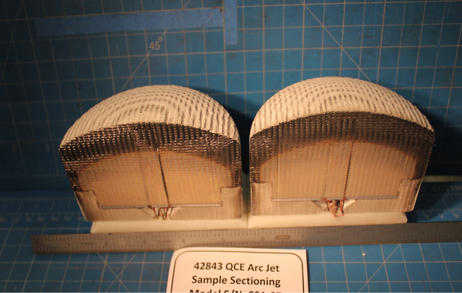 A Three-Dimensional Multi-Functional Ablative Thermal Protection (3D-MAT) sample after an arc jet test at NASA's Ames Research Center. The sample shows the charred layer from the extremely hot, high pressured test; below the charred layer is unaffected 3D-MAT material. Image Credit: NASA/Ames
