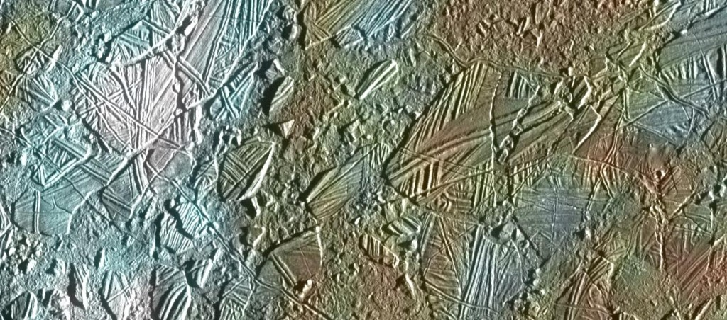 Bizarre features on Europa's icy surface suggest a warm interior. This view of the surface of Jupiter's moon Europa was obtained by NASA's Galileo mission, and shows a color image set within a larger mosaic of low-resolution monochrome images. Galileo was able to survey only a small fraction of Europa's surface in color at high resolution; a future mission would include a high-resolution imaging capability to capture a much larger part of the moon's surface. Image Credit: NASA/JPL-Caltech