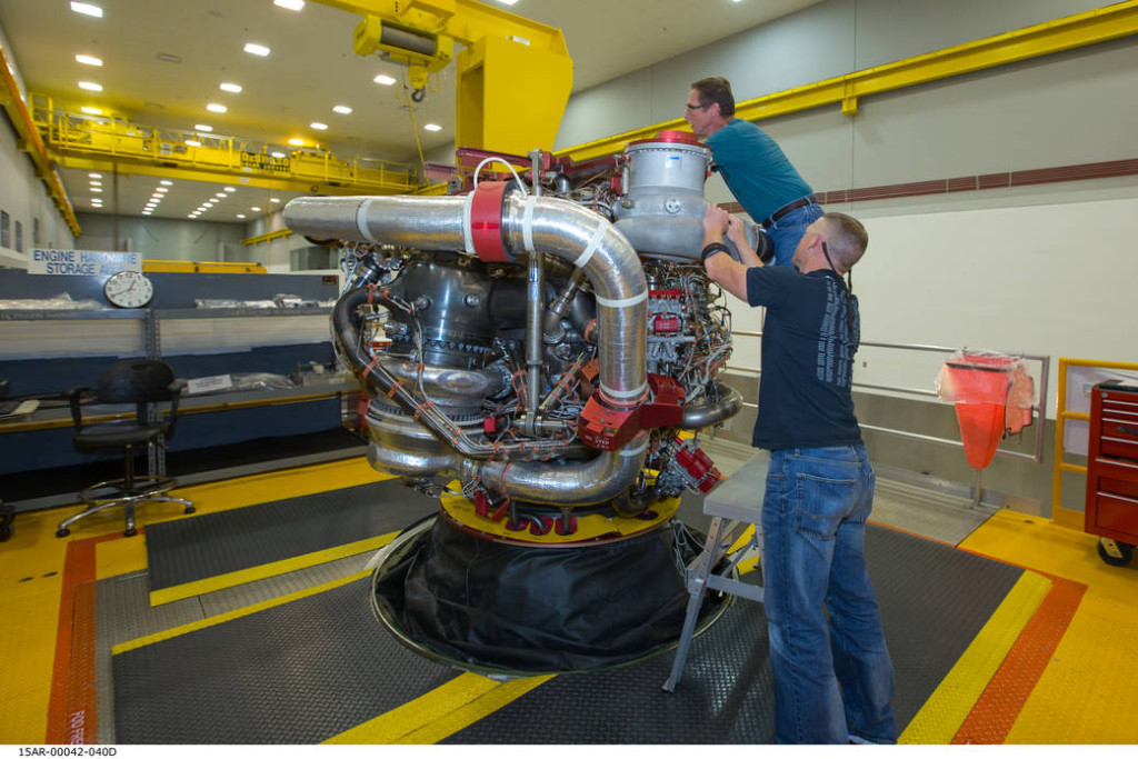 Aerojet Rocketdyne technicians put the final touches on the 16th engine for the RS-25 program. This engine will join three others to help propel the nation's most powerful rocket, the Space Launch System, which is currently in-development by NASA. Image credit: Aerojet Rocketdyne