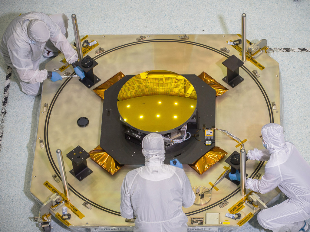 Technicians work with the secondary mirror of the James Webb Space Telescope in a clean room at NASA's Goddard Space Flight Center in Greenbelt, Maryland. Image Credit: NASA/Chris Gunn