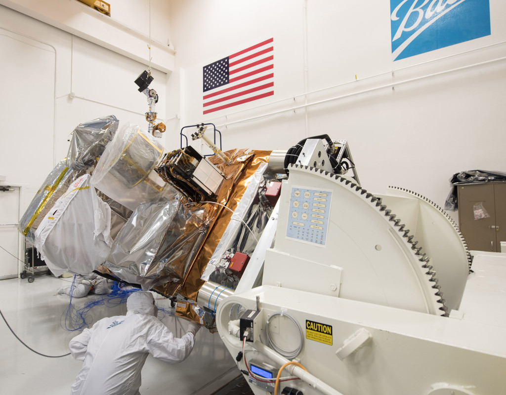 A Ball engineer inspects one of the sun sensors on the Joint Polar Satellite System( JPSS-1). Image Credit: Ball Aerospace