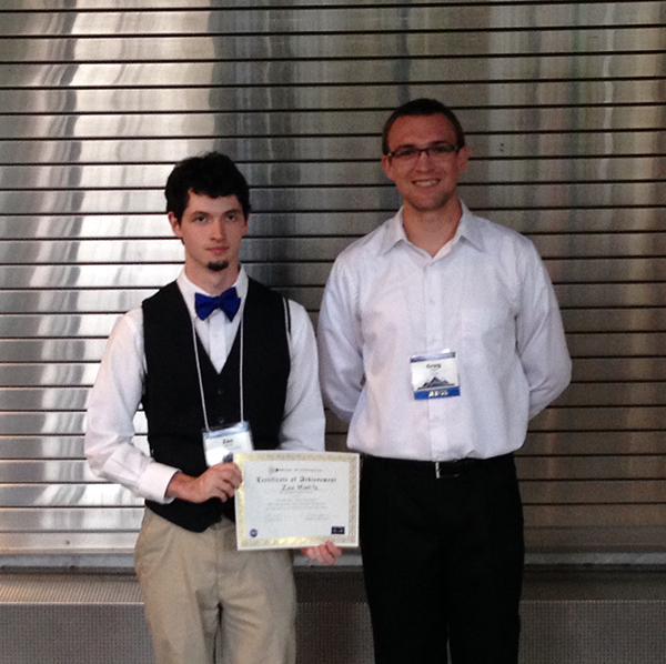 Mimlitz, left, is awarded the grand prize at the Colorado Undergraduate space Research Symposium by Greg Stahl of First RF Corporation. Image Credit: Colorado School of Mines
