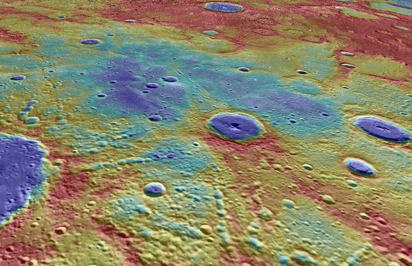 Above, in this perspective view, we look west across Suisei Planitia (blue colors), the site of some of the crustal magnetic signals. The plains are comprised of volcanic lava flows that erupted and solidified several billion years ago, filling the low areas between the higher topography (red colors).  The impact crater Kosho, 65 km in diameter, is seen in the center of the image (deep blue floor), and part of the crater Strindberg, 190 km in diameter, is seen in the lower left at the edge of the image.  The background image is Mercury Dual Imaging System global mosaic, colored by surface elevation measured by the Mercury Laser Altimeter (MLA), both draped over a digital elevation model derived from MLA data. Image Credit: NASA/Johns Hopkins University Applied Physics Laboratory/Carnegie Institution of Washington