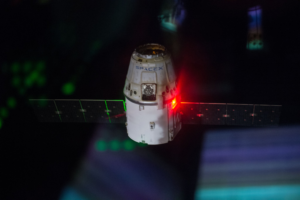 View of SpaceX Dragon CRS during undocking. Photo was taken during Expedition 41. Image Credit: NASA