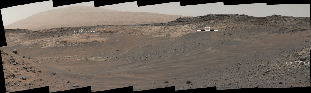 This May 10, 2015, view from Curiosity's Mastcam shows terrain judged difficult for traversing between the rover and an outcrop in the middle distance where a pale rock unit meets a darker rock unit above it. The rover team decided not to approach this outcrop and identified an alternative. Image Credit: NASA/JPL-Caltech/MSSS
