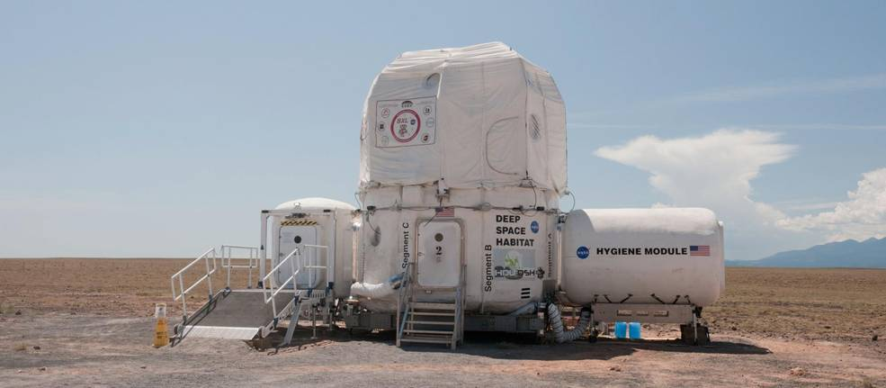 NASA architects, engineers and scientists are already busy creating sustainable, space-based living quarters, work spaces and laboratories for next-generation human term exploration, including our journey to Mars. This 2011 version of the deep space habitat at the Desert Research and Technology Studies (Desert RATS) analog field test site in Arizona features a Habitat Demonstration Unit, with the student-built X-Hab loft on top, a hygiene compartment on one side and airlock on the other. Image Credit: NASA