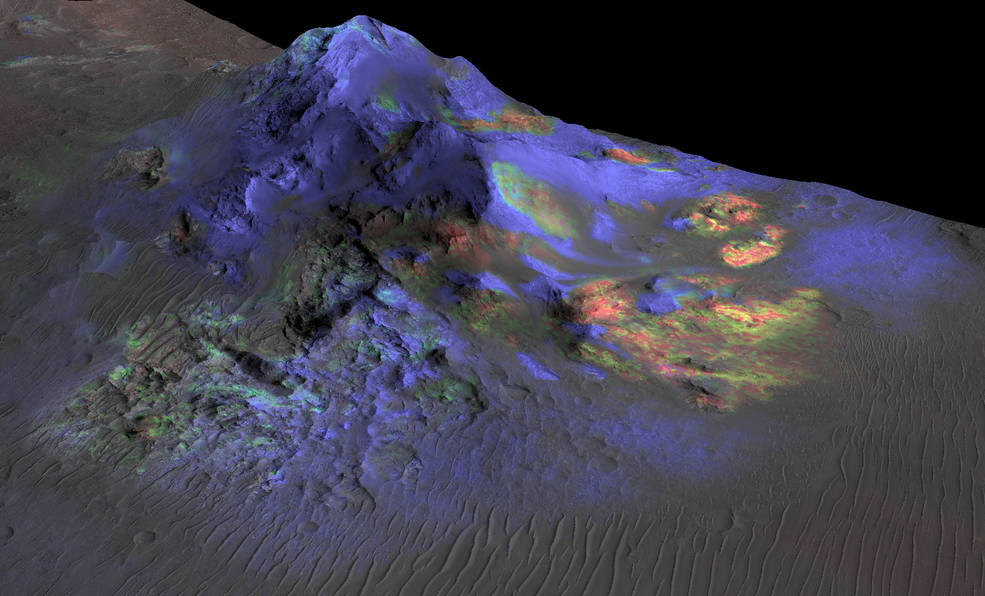 Researchers have found deposits of impact glass (in green) preserved in Martian craters, including Alga Crater, shown here. The detection is based on data from the instrument Compact Reconnaissance Imaging Spectrometer for Mars (CRISM) on NASA's Mars Reconnaissance Orbiter. Image Credit: NASA/JPL-Caltech/JHUAPL/Univ. of Arizona