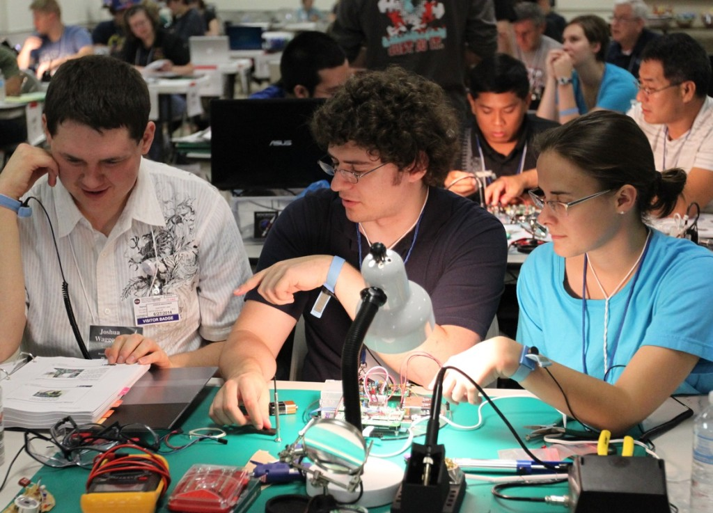 Participants work on their experiments for flight during the 2014 RockOn workshop. Image Credit: NASA