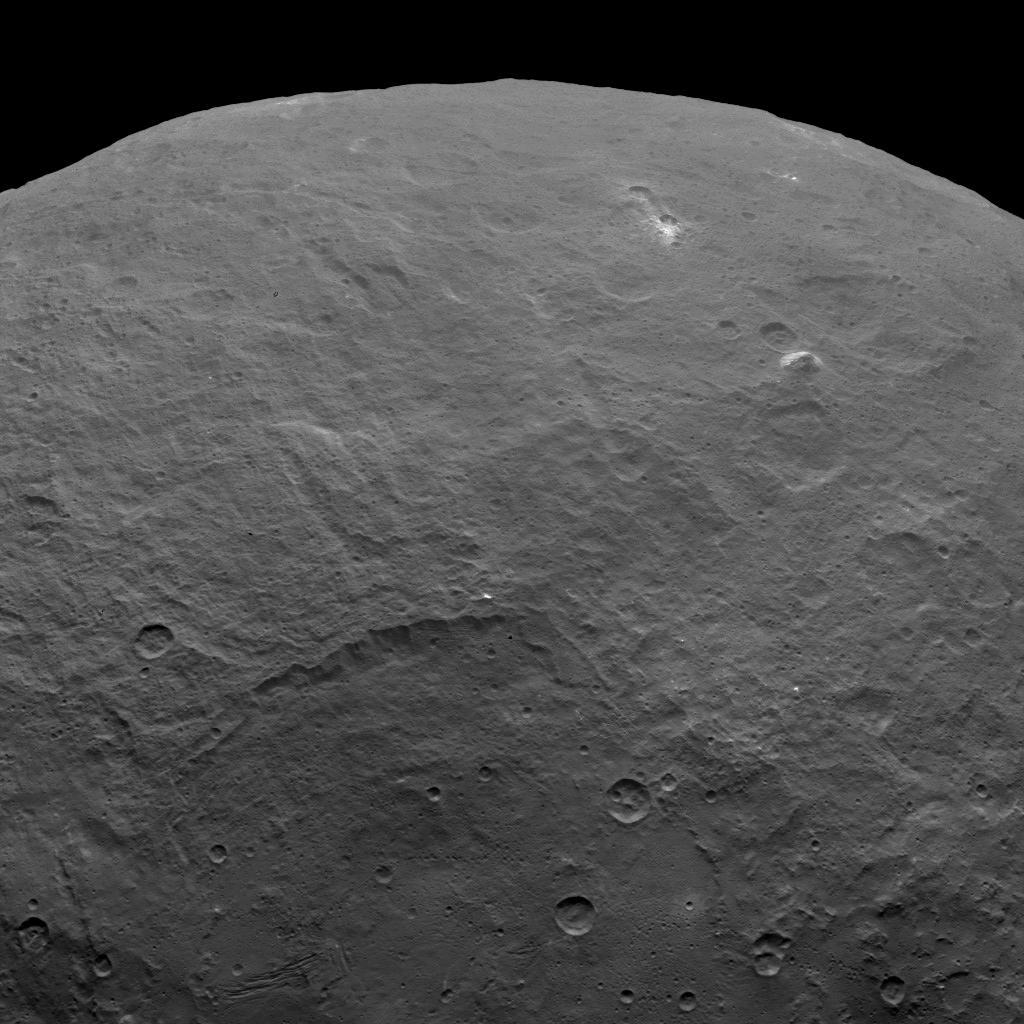 NASA's Dawn spacecraft took this image on June 6, 2015, which includes an intriguing pyramid-shaped mountain protruding from a relatively smooth area in the upper right. Image credit: NASA/JPL-Caltech/UCLA/MPS/DLR/IDA