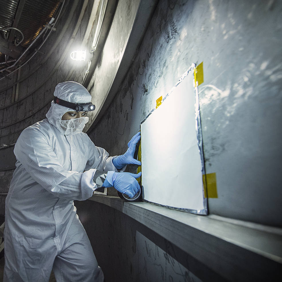 Thermal Coatings Engineer Nithin Abraham places a MAC panel at the very bottom of the Chamber A where the Webb telescope will be tested. Image Credit: NASA/Chris Gunn