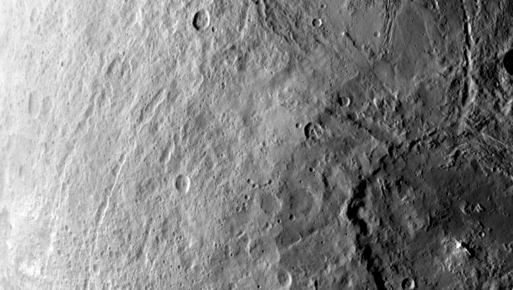 A large crater in the southern hemisphere of dwarf planet Ceres is seen in this image taken by NASA's Dawn spacecraft on June 6, 2015. Image Credit: NASA/JPL-Caltech/UCLA/MPS/DLR/IDA
