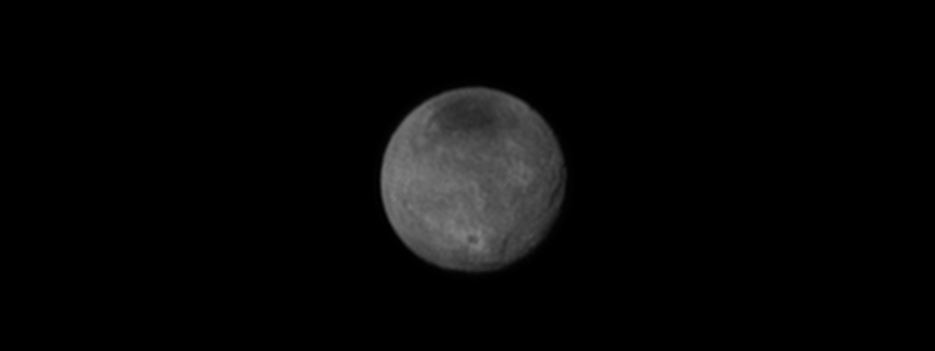 Chasms, craters, and a dark north polar region are revealed in this image of Pluto's largest moon Charon taken by New Horizons on July 11, 2015. Image Credit: NASA/JHUAPL/SWRI