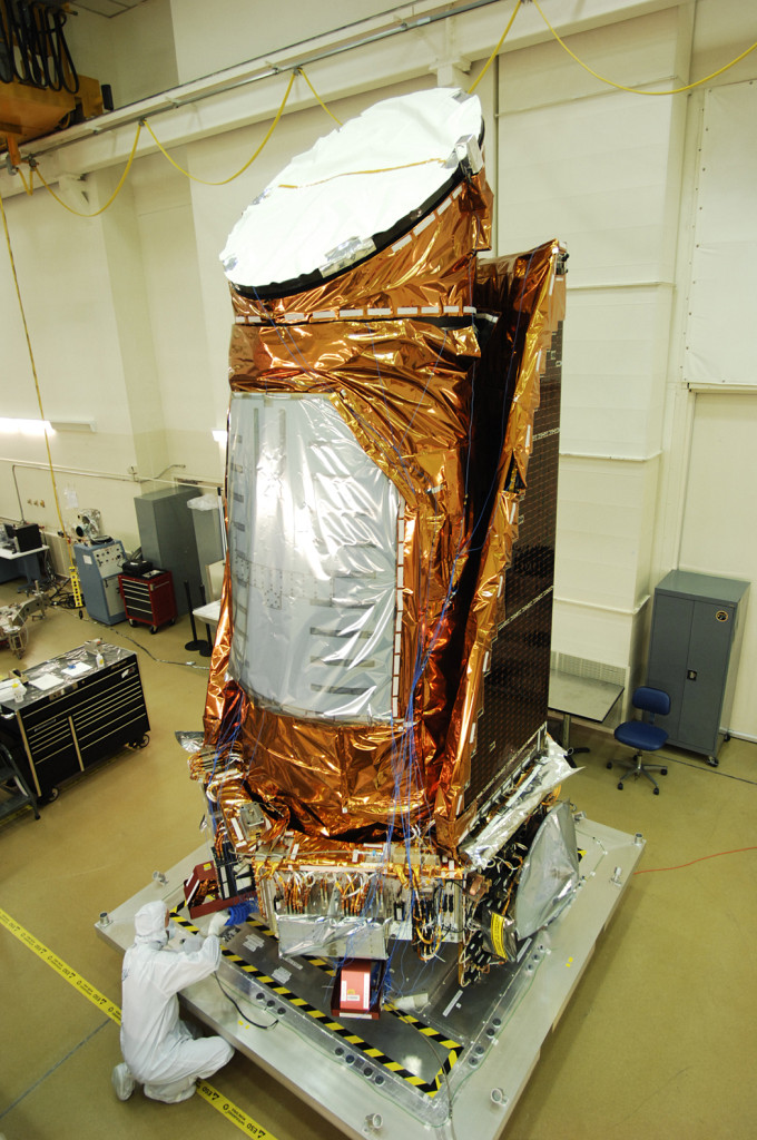 Kepler spacecraft fully assembled at the clean room facility at Ball Aerospace in Boulder, Colorado. Image Credit: NASA Ames/Ball Aerospace