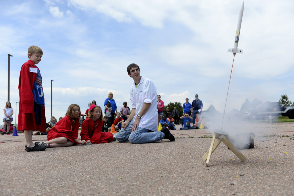 Schriever School Age Program students McKinley Cross (left), Kayden Rice and Hannah Withycombe launch the rocket they built, while Monahan LLC Science Camp staff member Sam Birchenough supervises, Thursday July 2, 2015 at Schriever Air Force Base, Colorado. Image Credit: U.S. Air Force/Christopher DeWitt