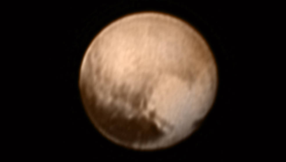 This image of Pluto from New Horizons' Long Range Reconnaissance Imager (LORRI) was received on July 8, and has been combined with lower-resolution color information from the Ralph instrument. Image Credit: NASA-JHUAPL-SWRI