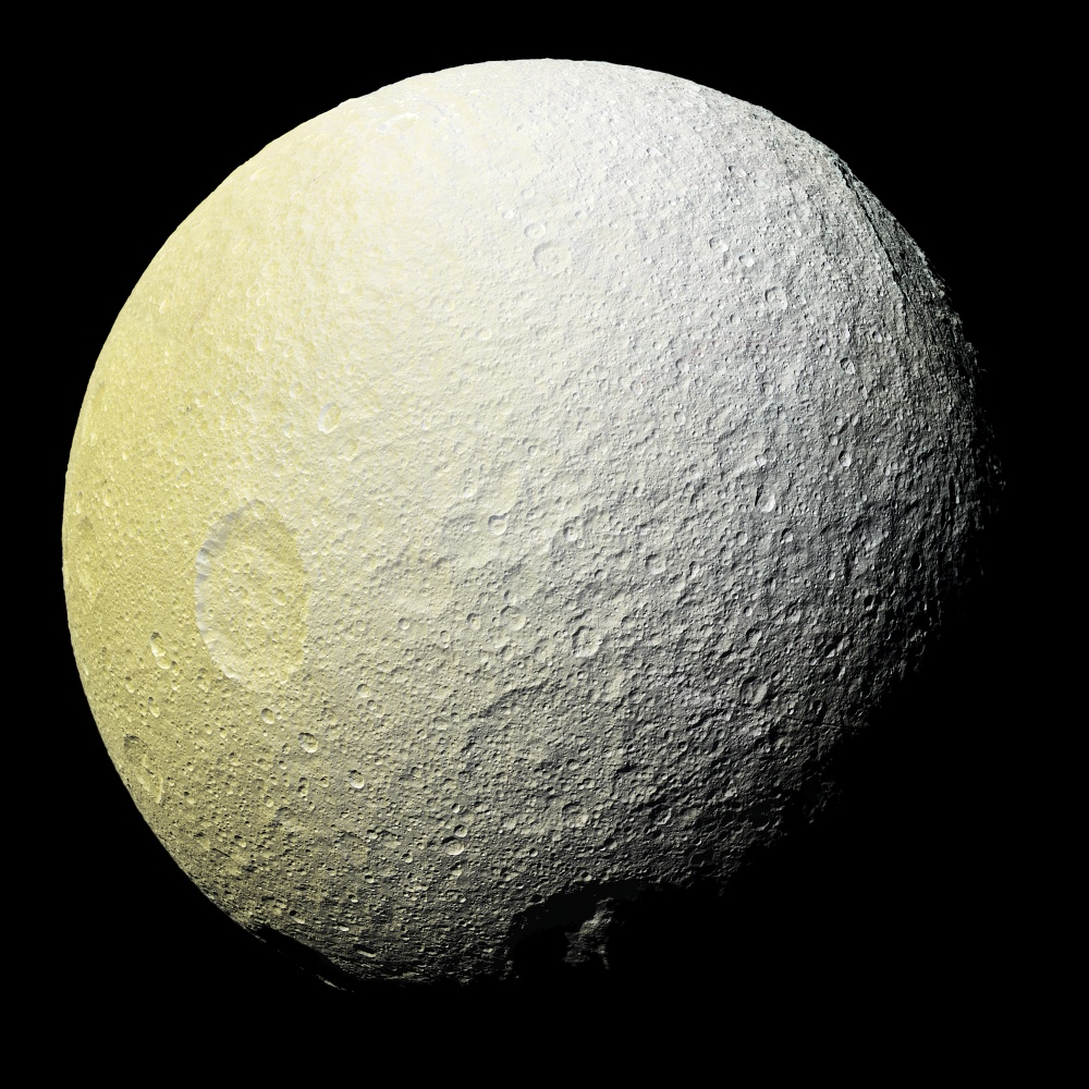 This enhanced-color mosaic of Saturn's icy moon Tethys shows a range of features on the moon's trailing hemisphere. Tethys is tidally locked to Saturn, so the trailing hemisphere is the side of the moon that always faces opposite its direction of motion as it orbits the planet. Image Credit: NASA/JPL-Caltech/SSI
