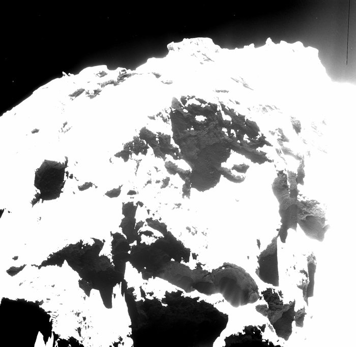 Active pits detected in the Seth region of Comet 67P/Churyumov­-Gerasimenko can be seen in the lower right portion of this OSIRIS wide-angle camera image. The largest, Seth_01, measures 220 m across and 185 m deep. Seth_02 and Seth_03 lie immediately to the left and measure 110 m and 140 m across, respectively. Image Credit: ESA/Rosetta/MPS for OSIRIS Team MPS/UPD/LAM/IAA/SSO/INTA/UPM/DASP/IDA