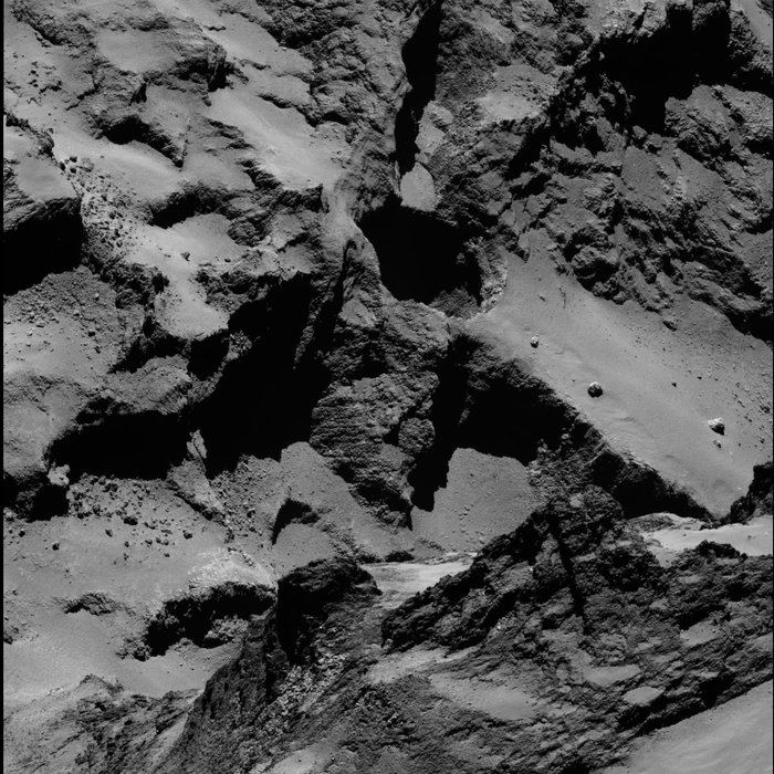 High-resolution view of active regions in Seth as seen with Rosetta's OSIRIS narrow-angle camera on 20 September 2014 from a distance of about 26 km from the surface. The image scale is about 45 cm/pixel. The Seth_01 pit is seen close to centre and measures approximately 220 m across and 185 m deep. The image also includes Seth_02 and Seth_03 to the 'top' of Seth_01, and Seth_04 and Seth_05 'below' (see context image for guidance). The image has not been enhanced to reveal the jets of activity, but instead focuses on the rich diversity of the comet's geology both inside the active regions and in the surrounds. Image Credit: ESA/Rosetta/MPS for OSIRIS Team MPS/UPD/LAM/IAA/SSO/INTA/UPM/DASP/IDA