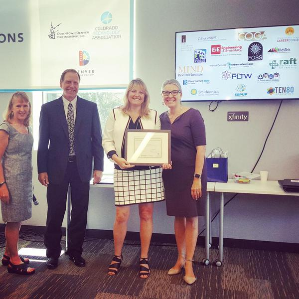 Stephanie Welsh from RAFT is congratulated for becoming a STEMworks partner. Image Credit: Colorado Education Initiative