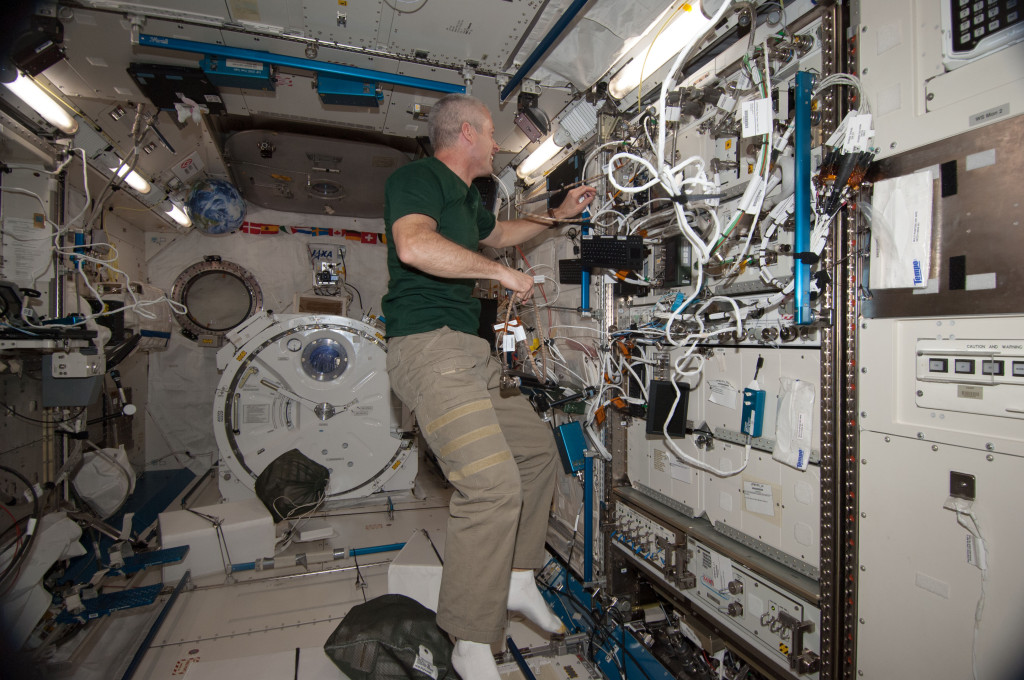 Expedition 39 flight engineer Steve Swanson works with the NanoRacks BioRack in the Kibo Japanese Experiment Pressurized Module (JPM), which includes the NanoRacks-CellBox-Thyroid Cancer investigation to study the effects of microgravity on human thyroid carcinoma cells. Image Credit: NASA