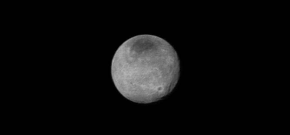 Charon's newly-discovered system of chasms, larger than the Grand Canyon on Earth, rotates out of view in New Horizons' sharpest image yet of the Texas-sized moon. It's trailed by a large equatorial impact crater that is ringed by bright rays of ejected material. In this latest image, the dark north polar region is displaying new and intriguing patterns. This image was taken on July 12 from a distance of 1.6 million miles (2.5 million kilometers). Image Credit: NASA/JHUAPL/SWRI