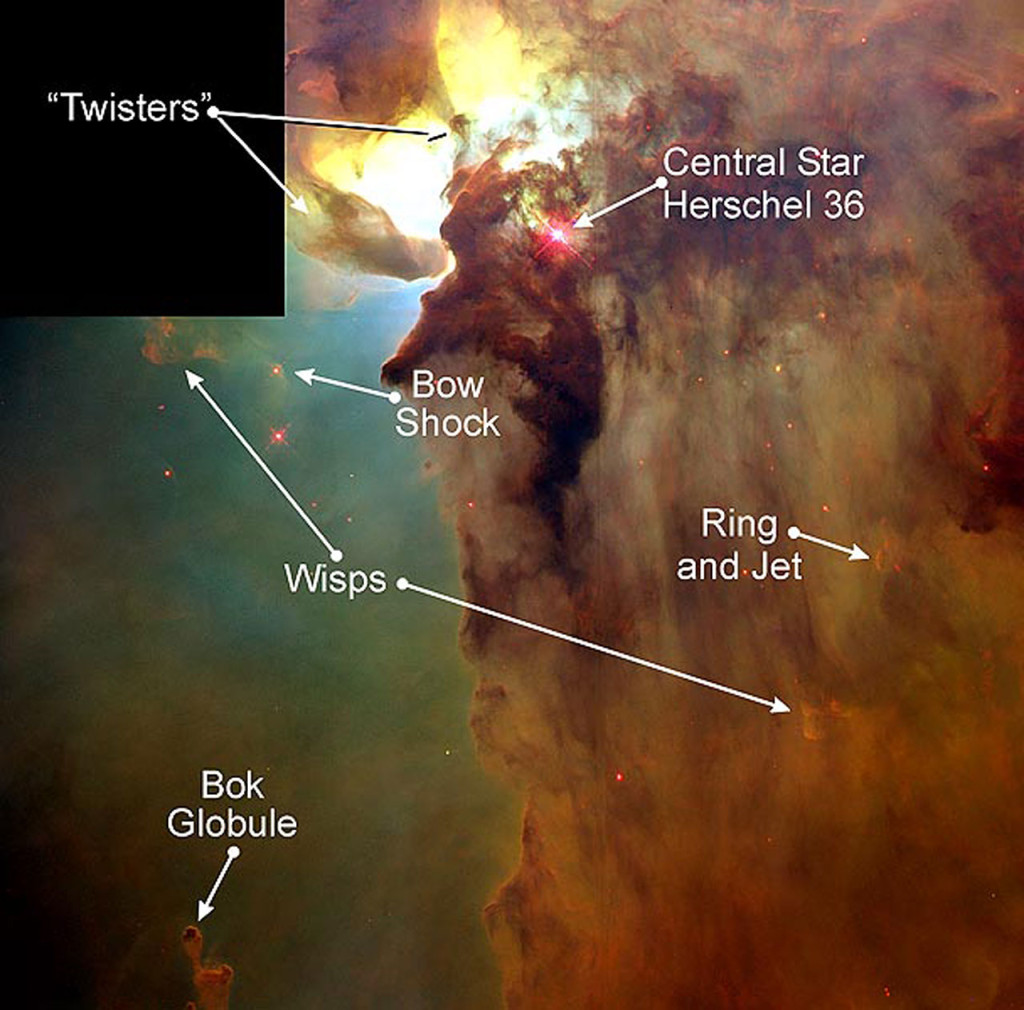 This Hubble Space Telescope (HST) image reveals a pair of one-half light-year long interstellar 'twisters' -- eerie funnels and twisted-rope structures (upper left) -- in the heart of the Lagoon Nebula (Messier 8) which lies 5, 000 light-years away in the direction of the constellation Sagittarius. Image Credit: A. Caulet (ST-ECF, ESA) and NASA