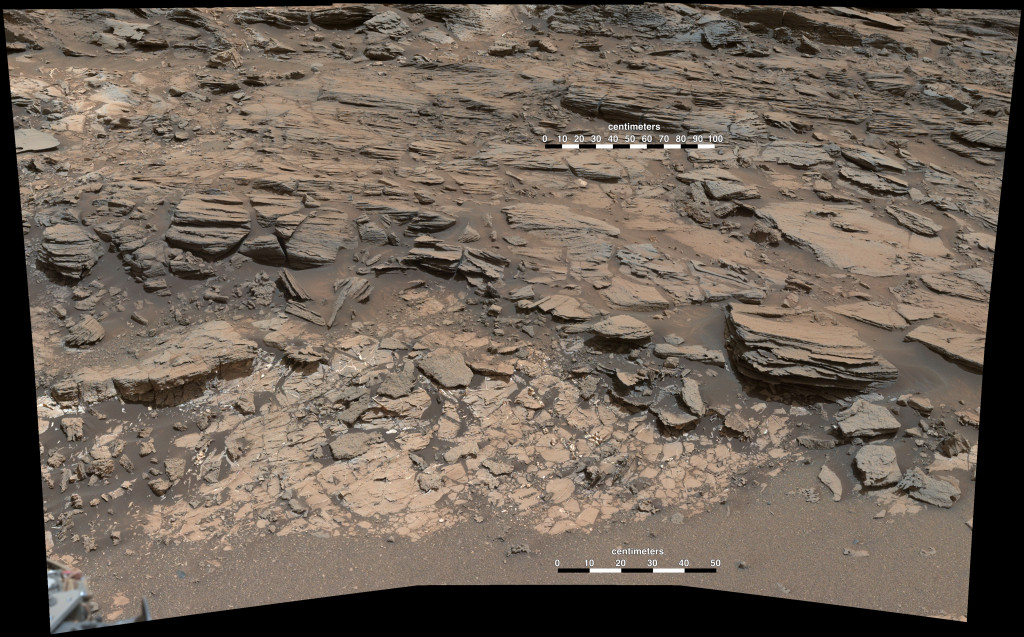 "This May 25, 2015, view from the Curiosity rover's Mastcam shows a site where two different types of bedrock meet near ""Marias Pass"" on Mount Sharp. Pale mudstone in the foreground is like bedrock the rover studied at ""Pahrump Hills."" The darker sandstone above it is called the Stimson unit. Image Credit: NASA/JPL-Caltech/MSSS"