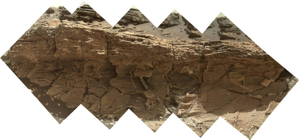 "A rock outcrop dubbed ""Missoula,"" near Marias Pass on Mars, is seen in this image mosaic taken by the Mars Hand Lens Imager on NASA's Curiosity rover. Pale mudstone (bottom of outcrop) meets coarser sandstone (top) in this geological contact zone, which has piqued the interest of Mars scientists. Image Credit: NASA/JPL-Caltech/MSSS"