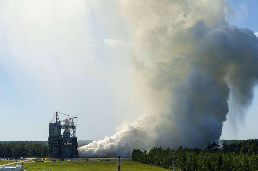 The RS-25 engine fires up for a 535-second test Aug. 27, 2015 at NASA's Stennis Space Center near Bay St. Louis, Mississippi. This is the final in a series of seven tests for the development engine, which will provide NASA engineers critical data on the engine controller unit and inlet pressure conditions. Image Credit: NASA