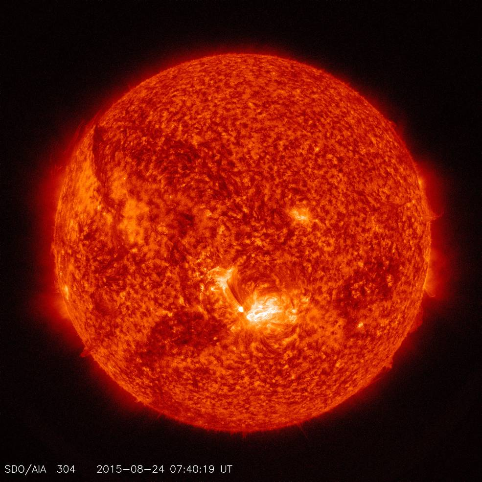 NASA's Solar Dynamics Observatory captured this image of a mid-level solar flare on the sun – as seen in the bright spot in the lower center of the solar disk on Aug. 24, 2015. The image shows a subset of extreme ultraviolet light that highlights the extremely hot solar material, which is typically colorized in red. Image Credit: NASA/SDO