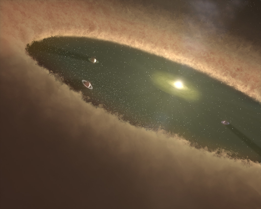This artist's concept of a young star system shows gas giants forming first, while the gas nebula is present. Southwest Research Institute scientists used computer simulations to nail down how Jupiter and Saturn evolved in our own solar system. These new calculations show that the cores of gas giants likely formed by gradually accumulating a population of planetary pebbles – icy objects about a foot in diameter. Image Credit: NASA/JPL-Caltech