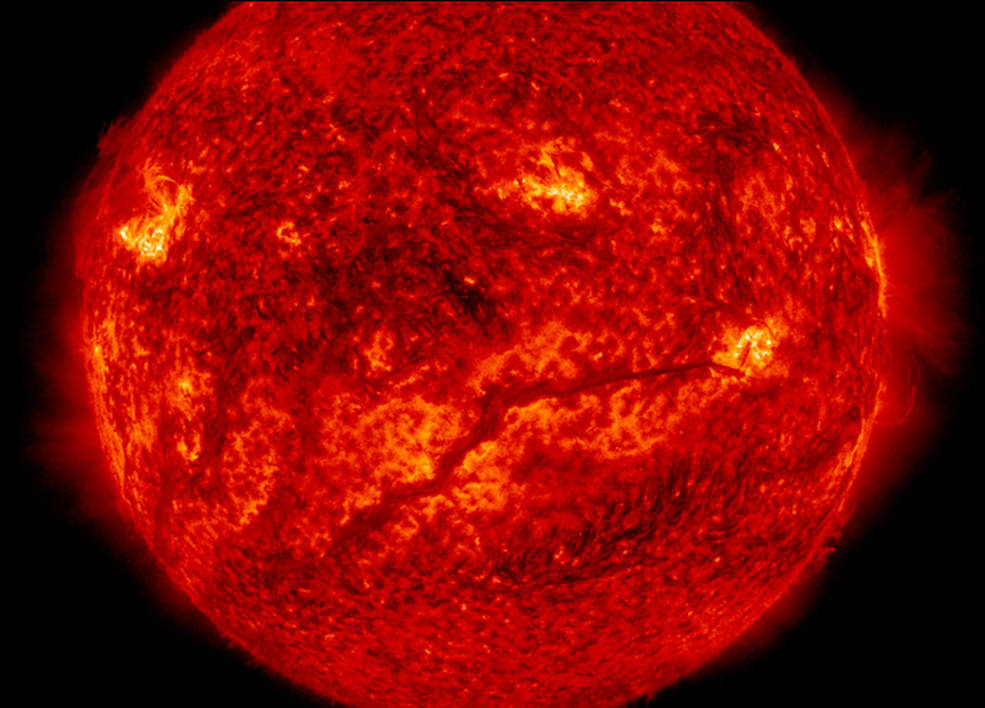 A filament stretches across the lower half of the sun in this image captured by NASA's Solar Dynamics Observatory on Feb. 10, 2015. Filaments are huge tubes of relatively cool solar material held high up in the corona by magnetic fields. Researchers simulated how the material moves in filament threads to explore how a particular type of motion could contribute to the extremely hot temperatures in the sun's upper atmosphere, the corona. Image Credit: NASA/SDO