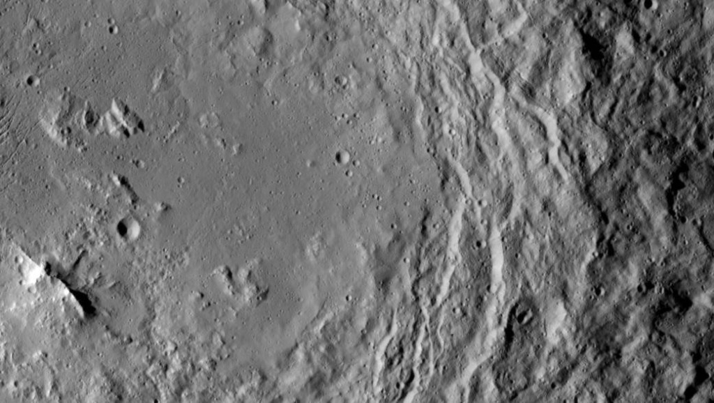 NASA's Dawn spacecraft took this image that shows a mountain ridge, near lower left, that lies in the center of Urvara crater on Ceres. Image Credit: NASA/JPL-Caltech/UCLA/MPS/DLR/IDA