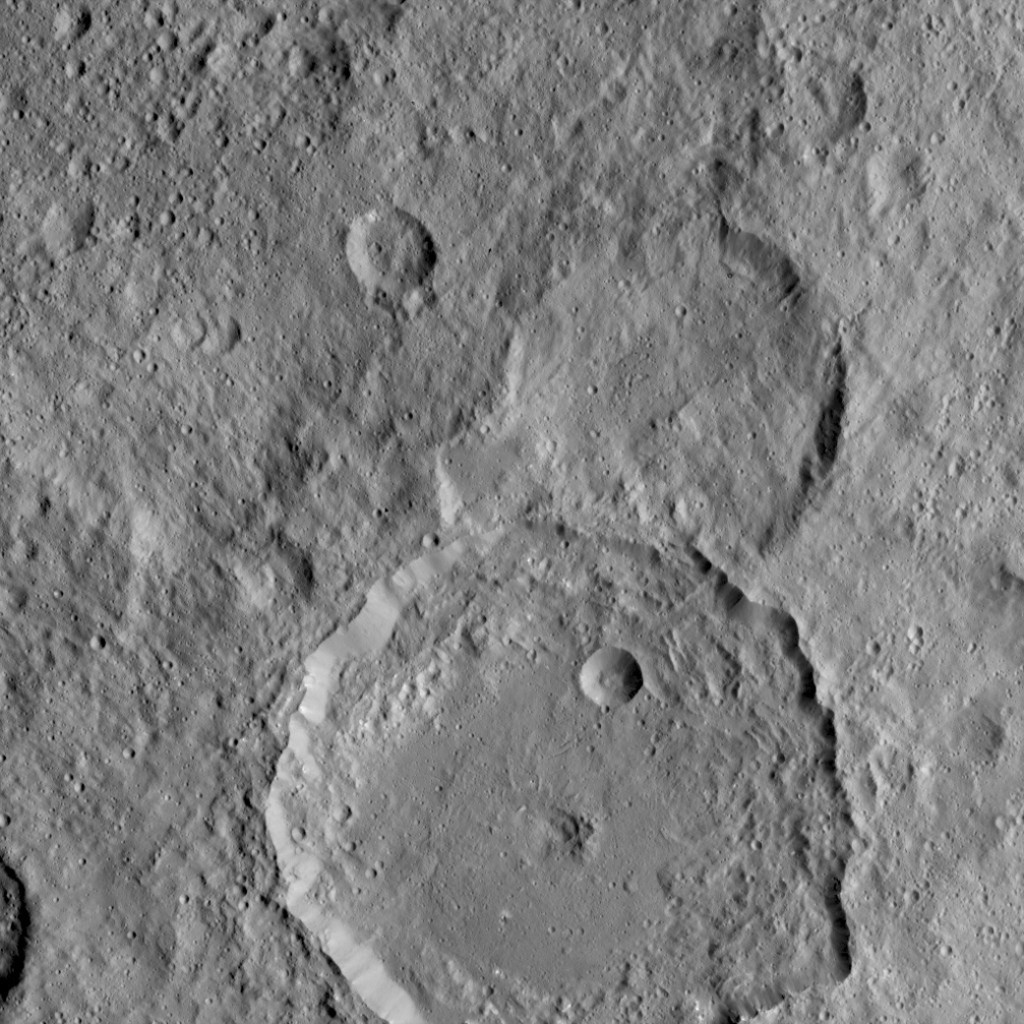 NASA's Dawn Spacecraft took this image of Gaue crater, the large crater on the bottom, on Ceres.  Image Credit: NASA/JPL-Caltech/UCLA/MPS/DLR/IDA