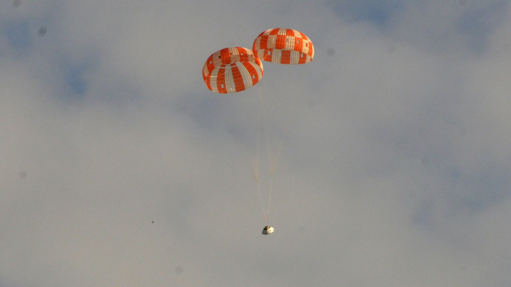 A test version of NASA's Orion spacecraft successfully landed under two main parachutes in the Arizona desert Aug. 26. Image Credit: NASA