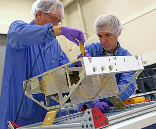 Engineers begin construction of the first of eight microsatellites for NASA's Cyclone Global Navigation Satellite System at the Southwest Research Institute in San Antonio, Texas. Communication antennas, attitude control, GPS receiver, and other instrumentation will be installed on the satellite frame in the coming weeks. Image Credit: SwRI