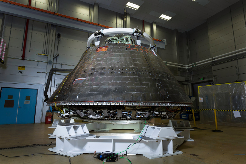 The Orion crew module is placed in a secure stand where it will undergo decontamination. Image Credit: Lockheed Martin