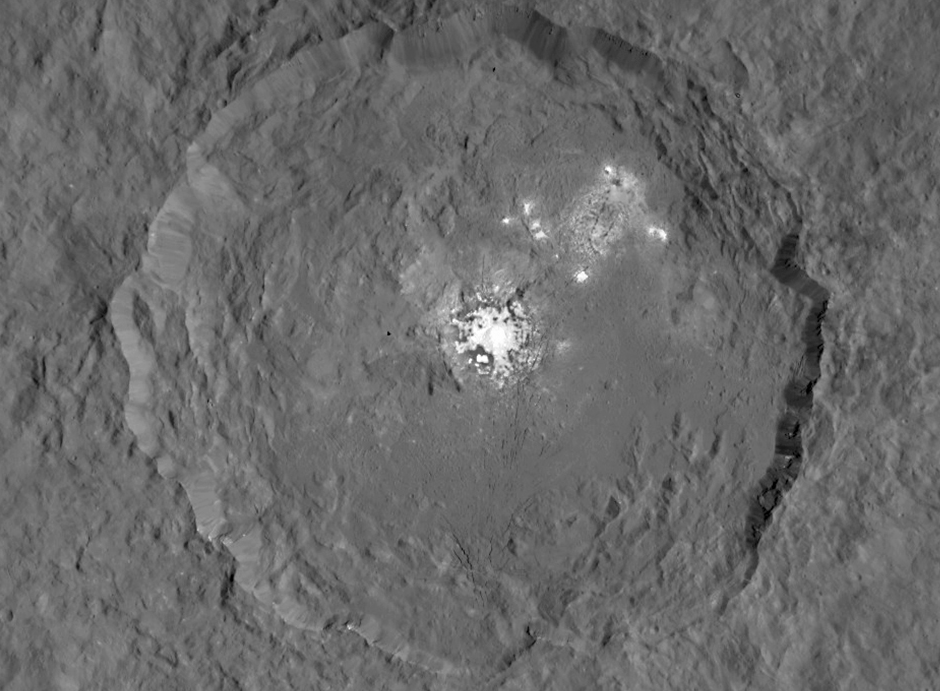 This image, made using images taken by NASA's Dawn spacecraft, shows Occator crater on Ceres, home to a collection of intriguing bright spots. Image credit: NASA/JPL-Caltech/UCLA/MPS/DLR/IDA