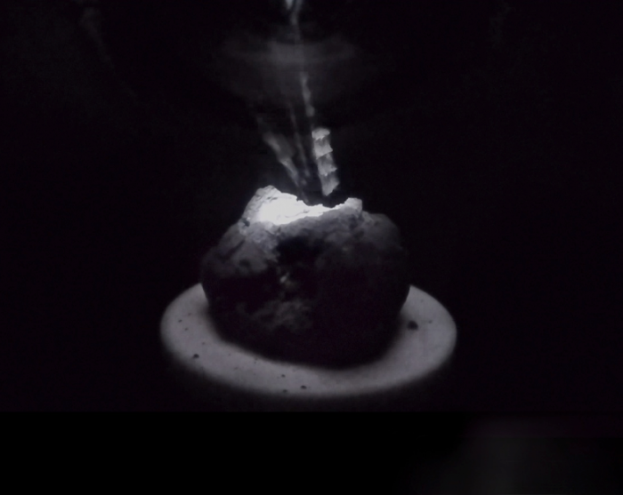 Spalling of an asteroid simulant heated by an optical source. Image Credit: Colorado School of Mines
