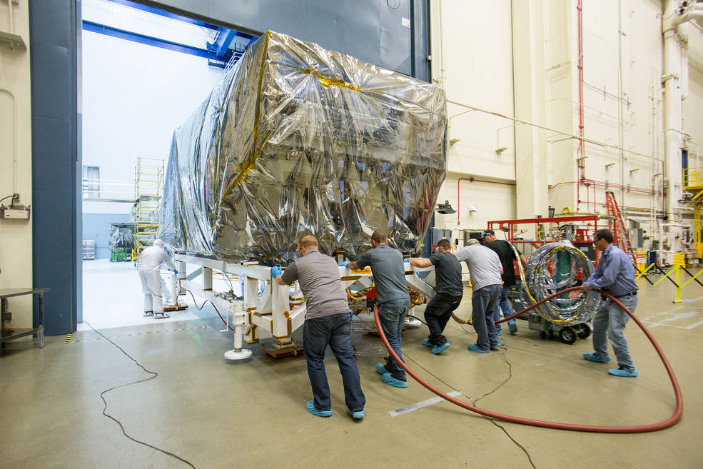 The wrapped up ISIM structure pushed back to the clean room post acoustics-test, to prepare for the EMI test. Image Credit: NASA/Desiree Stover