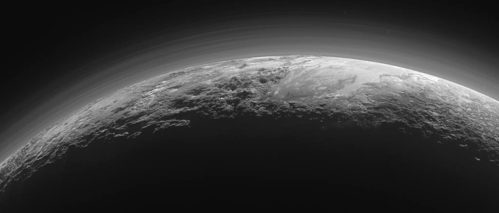 Pluto's Majestic Mountains, Frozen Plains and Foggy Hazes: Just 15 minutes after its closest approach to Pluto on July 14, 2015, NASA's New Horizons spacecraft looked back toward the sun and captured this near-sunset view of the rugged, icy mountains and flat ice plains extending to Pluto's horizon. The smooth expanse of the informally named icy plain Sputnik Planum (right) is flanked to the west (left) by rugged mountains up to 11,000 feet (3,500 meters) high, including the informally named Norgay Montes in the foreground and Hillary Montes on the skyline. To the right, east of Sputnik, rougher terrain is cut by apparent glaciers. The backlighting highlights over a dozen layers of haze in Pluto's tenuous but distended atmosphere. The image was taken from a distance of 11,000 miles (18,000 kilometers) to Pluto; the scene is 780 miles (1,250 kilometers) wide. Image Credit: NASA/JHUAPL/SwRI