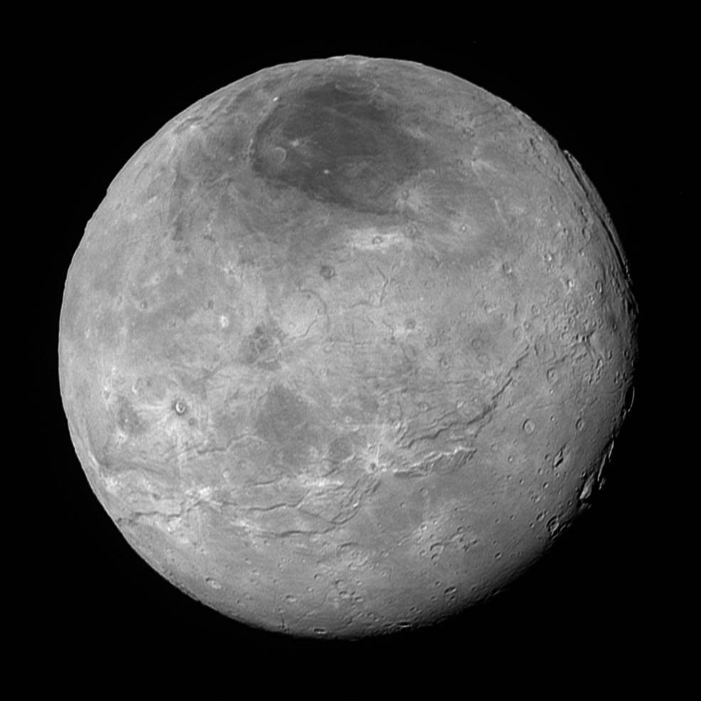 This image of Pluto's largest moon Charon, taken by NASA's New Horizons spacecraft 10 hours before its closest approach to Pluto on July 14, 2015 from a distance of 290,000 miles (470,000 kilometers), is a recently downlinked, much higher quality version of a Charon image released on July 15. Charon, which is 750 miles (1,200 kilometers) in diameter, displays a surprisingly complex geological history, including tectonic fracturing; relatively smooth, fractured plains in the lower right; several enigmatic mountains surrounded by sunken terrain features on the right side; and heavily cratered regions in the center and upper left portion of the disk. There are also complex reflectivity patterns on Charon's surface, including bright and dark crater rays, and the conspicuous dark north polar region at the top of the image. The smallest visible features are 2.9 miles 4.6 kilometers) in size. Image Credit: NASA/Johns Hopkins University Applied Physics Laboratory/Southwest Research Institute