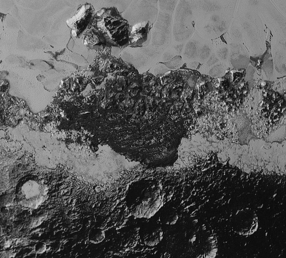This 220-mile (350-kilometer) wide view of Pluto from NASA's New Horizons spacecraft illustrates the incredible diversity of surface reflectivities and geological landforms on the dwarf planet. The image includes dark, ancient heavily cratered terrain; bright, smooth geologically young terrain; assembled masses of mountains; and an enigmatic field of dark, aligned ridges that resemble dunes; its origin is under debate. The smallest visible features are 0.5 miles (0.8 kilometers) in size. This image was taken as New Horizons flew past Pluto on July 14, 2015, from a distance of 50,000 miles (80,000 kilometers). Image Credit: NASA/Johns Hopkins University Applied Physics Laboratory/Southwest Research Institute
