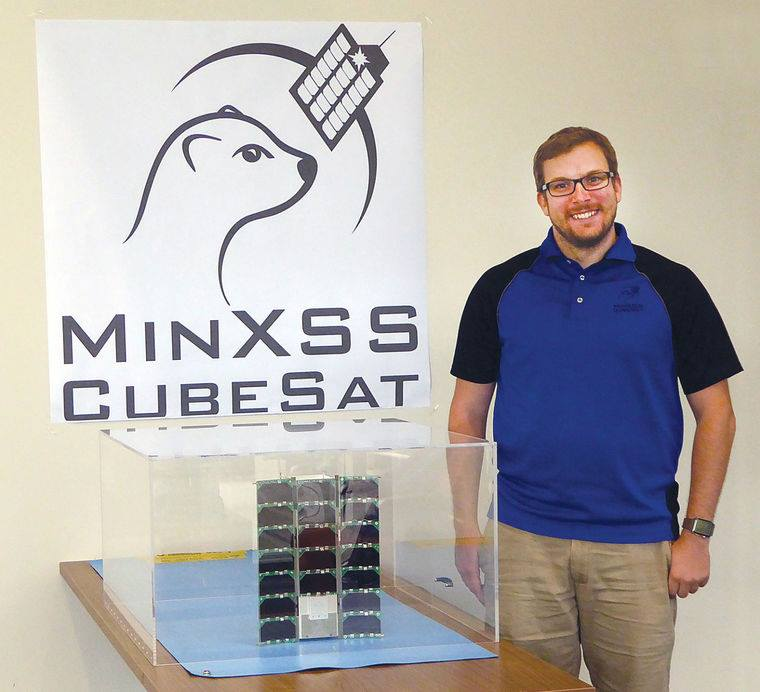University of Colorado Boulder graduate student James Mason is the project manager for the most recent CubeSat mission designed and built at LASP, the Miniature X-Ray Solar Spectrometer (MinXSS). Image Credit: LASP